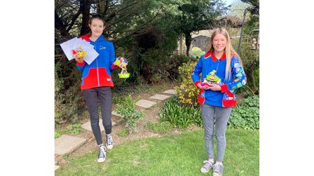 Lola and Hattie of 1st Rushmere Guides with some of the cards for residents of Prince George House