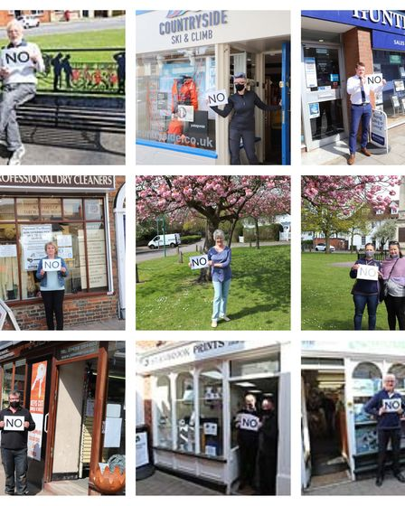Stevenage Old Town High Street free parking loss protesters holding 'no' signs