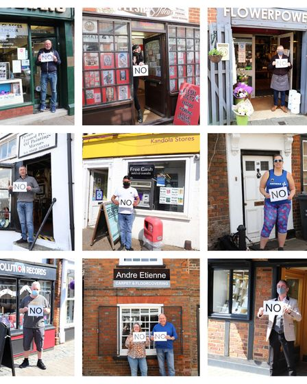 Stevenage Old Town High Street business owners holding 'no' signs in protest of plans to get rid of free parking