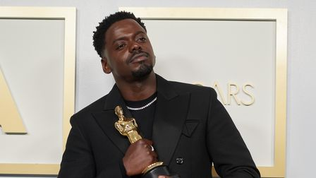 Daniel Kaluuya poses backstage with the Oscarfor Best Actor in a Supporting Role during the live ABC Telecast