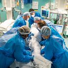The proning team working together to 'prone' a patient