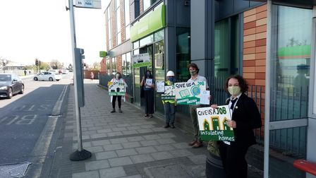 Wanstead Climate Action demonstrating outside Seven Kings Jobcentre