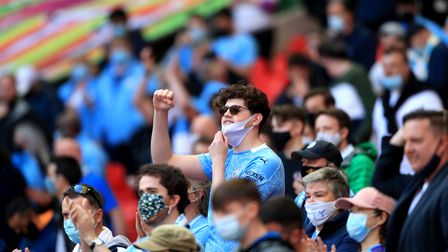 A general view of a Manchester City fan in the stands ahead of the Carabao Cup Final at Wembley Stad
