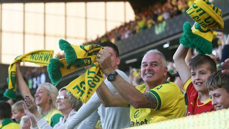 The home fans celebrate their sideÕs 3rd goal during the Premier League match at Carrow Road, Norwic