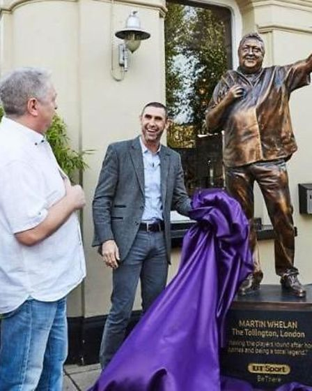 Tollington Arms landlord Martin Whelan (alongside a bronze statue of himself) with former Arsenal defender Martin Keown