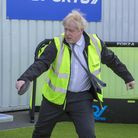 Prime Minister Boris Johnson plays table tennis during a visit to Wrexham
