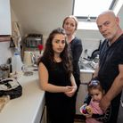 Family living in poor housing, Harlesden Gardens: