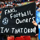 Manchester City fans at Wembley hold abanner protesting against the European Super League ahead of victory against Spurs