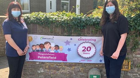 Staff celebrating the 20th anniversary of Petersfield in Portishead.