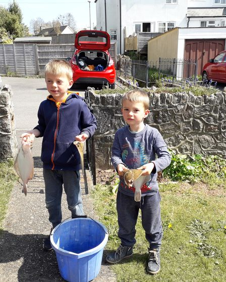 Roman and Marcus Lowe with a couple of Plaice for their tea
