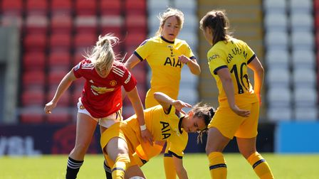 Tottenham Hotspur's Rosella Ayane (centre) and Manchester United's Kirsty Smith (left) battle for th
