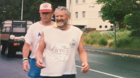 John Harris completing a marathon