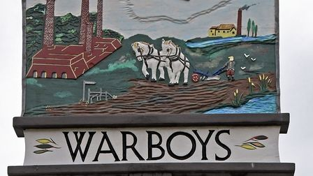 The village sign in Warboys shows the witches.