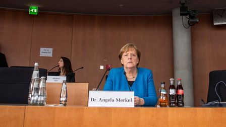 Angela Merkel is seated prior to testifying in front of a parliamentary committee investigating the Wirecard scandal
