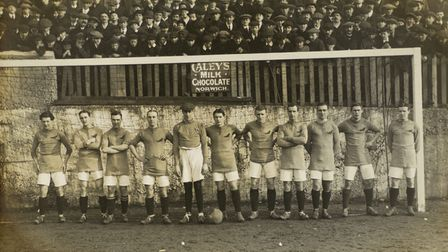 The 1913 Norwich City Football Team line up in front of a goal