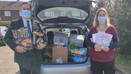 Purwell Primary's head Richard Cano alongside Lenka McAlinden, founder of Just Be A Child,with the donated books