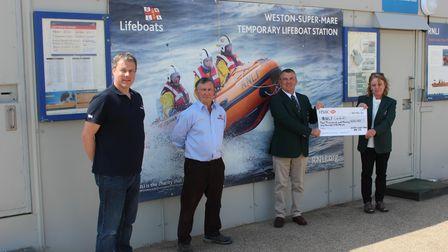 Mike Buckland and Peter Elmont from Weston RNLI with Andrew Balcombe and Alison Whitewood from Weston Golf Club.
