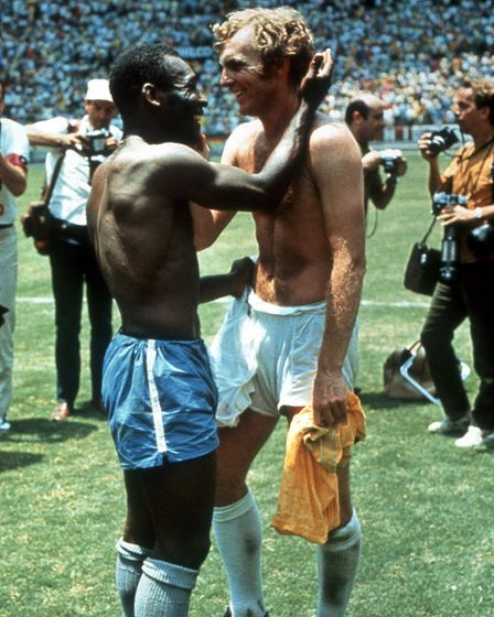 Pele of Brazil and Bobby Moore of England exchange shirts after the World Cup Group C game at the Es