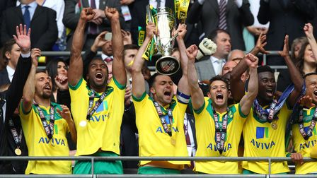 Norwich City captain Russell Martin lifts the Championship play-off final trophy after beating Middlesbrough 2-0