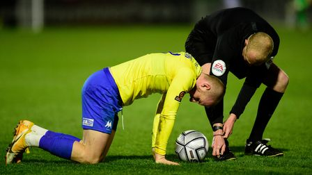 Connor Lemonheigh-Evans of Torquay United goes down injured during the National League match between