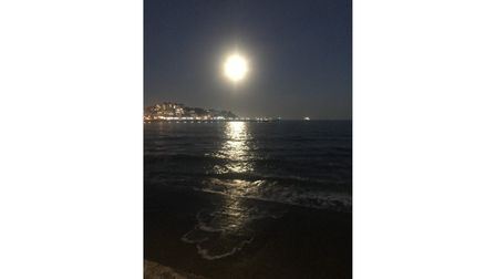 Moon shines over waterfront