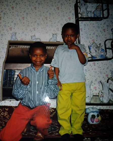 A childhood photo of Yaya Mbye Sankareh (left) and his younger brother.
