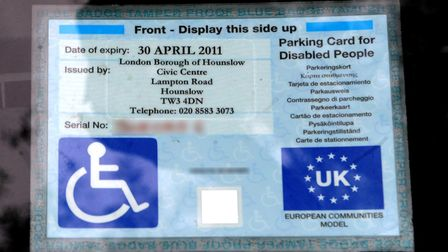 PLEASE NOTE THAT SOME DETAILS HAVE BEEN BLURRED BY THE PA PICTURE DESK. A disabled parking badge is