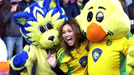 Myleene Klass on the pitch with Splatt the cat and Captain Canary before the NCFC v Watford match.