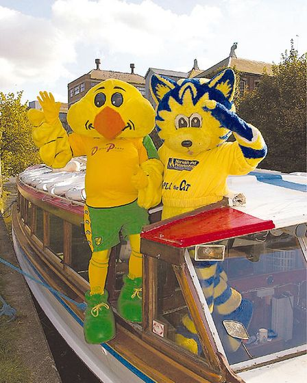 All aboard, Captain Canary and Splat the Cat on the football cruiser as it arrives at Carrow rd.