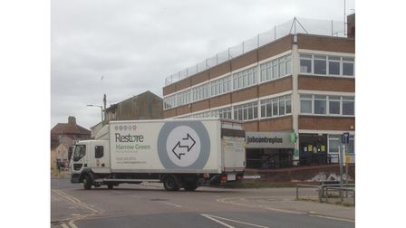One of the lorries involved in the archives decant leaves Lowestoft Library for Ipswich.