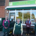 Four ladies stood outside village shop