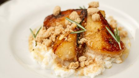 Roasted pears withrosemary andlemon infused honey,ricotta andalmond crumble