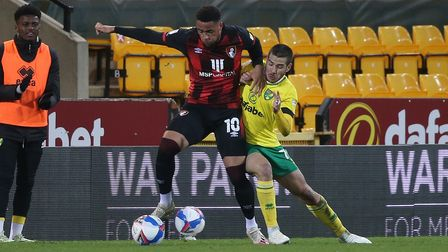 Arnaut Danjuma of Bournemouth and Emiliano Buendia of Norwich in action during the Sky Bet Champions