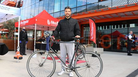 Alessandro Rochi, theatre manager at Royal London Hospital, with one of the bicycles.