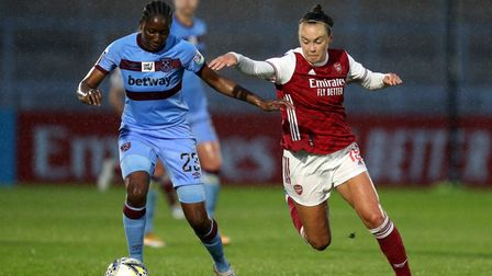 West Ham United's Hawa Cissoko (left) and Arsenal's Caitlin Foord battle for the ball during the FA