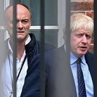 Boris Johnson (R) and former special advisor Dominic Cummings leave from the rear of Downing Street