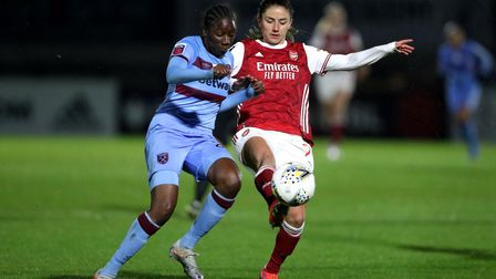 Arsenal's Danielle Van de Donk (right) and West Ham United's Hawa Cissoko battle for the ball during