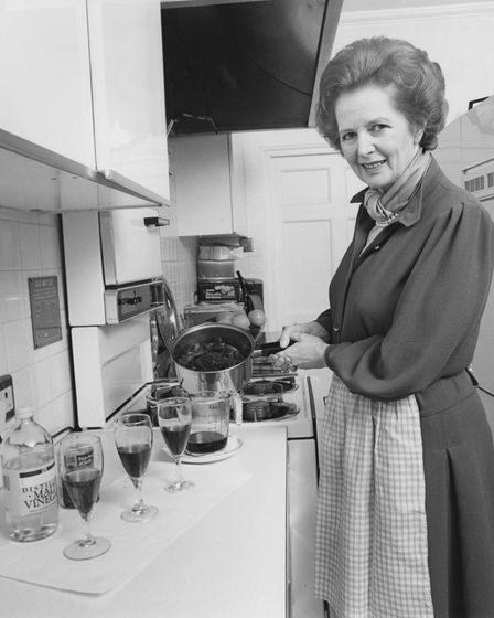 Prime Minister Margaret Thatcher pictured cooking red cabbage in the kitchen of 10 Downing Street, p