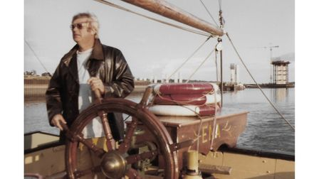 Eric Benton at the helm of Thames sailing barge Ena during the holiday