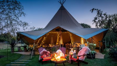 Sit with a cocktail around the firepit at The Weeping Willow