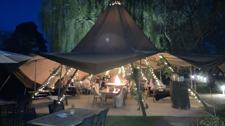 The Tipi on the Stream at Tuddenham Mill looks magical as the sun goes down. A great location and a