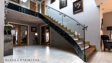 Glass and Stainless bespoke glass and stainless steel staircase in a home in Cheshire