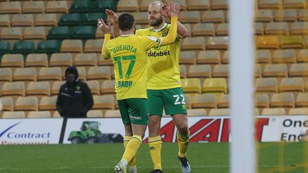 Teemu Pukki and Emi Buendia celebrate Norwich City's sixth goal during their thrashing of Huddersfie