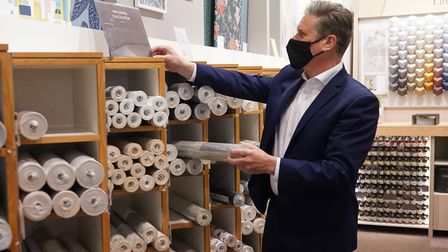 Labour Party leader Sir Keir Starmer browses through the wallpaper section at John Lewis