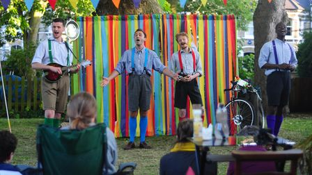 The Handlebards open the show with a song