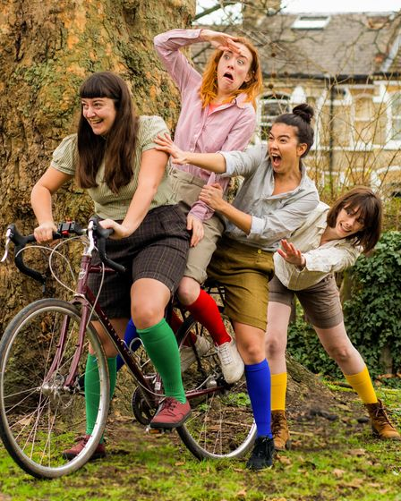 The female actors on a bicycle