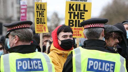 Police hold back demonstrators during a 'Kill The Bill' protest against The Police, Crime, Sentencin