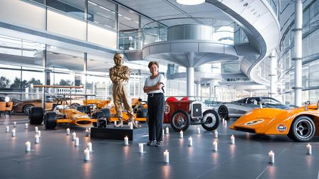 Bruce McLaren's daughter Amanda next to his statue -unveiled at McLaren's HQ on the 50th anniversary of his death