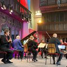 A group of musicians gathered together in a church