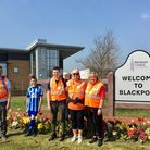 Zak Swire and family in Blackpool after their 238-mile walk.
